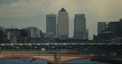 4K video of Canary Wharf and Blackfriars Bridge in London at dusk Stock Footage