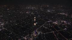 Aerial illuminated Skytree broadcasting Tower Sumida district Tokyo - stock footage