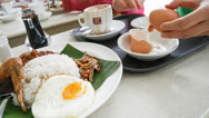 Stock Video Footage of 4k Ultra HD time lapse video on eating Nasi lemak and boiled egg(TL-MEAL 60)