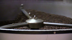 Roasted coffee beans in the coffee roaster Stock Footage