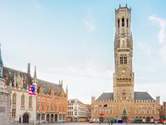 Belfry of Bruges and Grote Markt square, Belgium Stock Photos