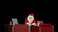 Santa Claus at work, Alpha Channel Stock Footage