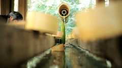 Meiji Jingu Shrine Yoyogi Park Shinto Shrine hand washing Tokyo Stock Footage