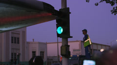 Shuttle Endeavor crosses intersection worker checks clearance 4K Stock Footage