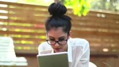 Girl using iPad tablet technology in the park 03 Stock Footage