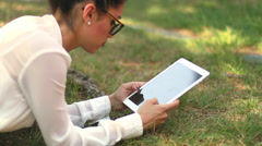 Stock Video Footage of Clerk with iPad tablet computer in the park 01