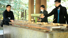 Temizu hand washing religion Meiji Jingu Shrine Yoyogi Park Tokyo - stock footage