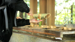 Stock Video Footage of Temizu hand washing religion Meiji Jingu Shrine Yoyogi Park Tokyo