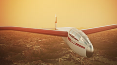 Sailplane over snow capped mountains. Glider flying wings - stock footage