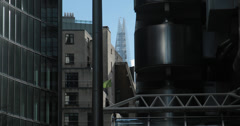 4K video of The Shard partially hidden by the Lloyd's building in London Stock Footage