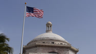 State capitol building and american flag Stock Footage