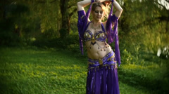 Belly dance dancer outside bellydance Stock Footage