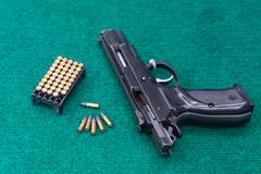 .22 pistol ammo pack - stock photo