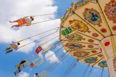 Swing seat exciting amusement ride Stock Photos