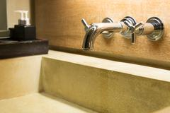 hot cold separated shiny metal water tap - stock photo