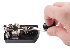 hand with morse key isolated - stock photo