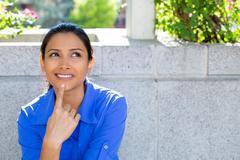 Closeup portrait, charming upbeat smiling joyful happy young woman looking up Kuvituskuvat