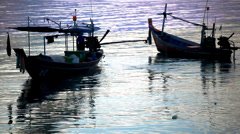Thai fisherman prepares to sail for Fish in the sea at sunset. Video Stock Footage