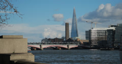 4K video of The Shard towering above the River Thames in London Stock Footage