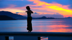 Happy Woman Jumping in Sea Sunset on Samui island, Thailand. Video slow motion Stock Footage