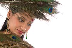 Indian female with peacock feathers. Stock Photos