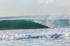 wave crashing hollow blue power - stock photo