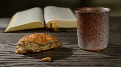Stock Video Footage of bible with chalice and bread, panning,sliding, tilt