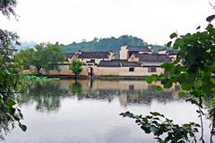Hongcun village enshrouded with mist in anhui province, china Stock Photos