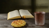 Stock Video Footage of bible with chalice and bread,rack focus