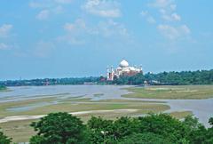 Taj mahal seen across the rive Stock Photos