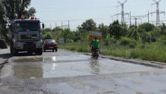 Disinfection of vehicles at the exit of town after great floods Stock Footage