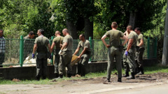 Soldiers helping people in cleaning garbage after floods from houses Stock Footage