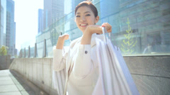 Ethnic Asian Female Retail Consumer Designer Shopping Bags Fashion Industry - stock footage
