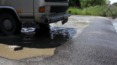 Disinfection of vehicles at the exit of town after great floods,close up. - stock footage