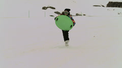 Young girls with sled, sledge or toboggan in the snow - stock footage