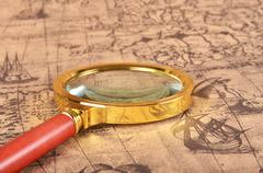 Magnifying glass on the map Stock Photos