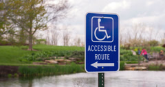 Handicap accessible route sign at park 4k Stock Footage