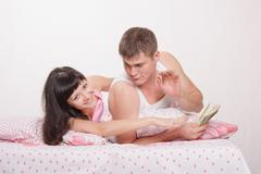 husband and wife share advance - stock photo