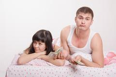 young couple is not enough money to buy an apartment - stock photo