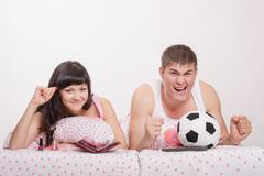 man watches football fanatic wife goes crazy already - stock photo