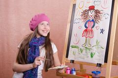 Stock Photo of painter girl thought about his work