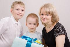 portrait of a happy family with gifts - stock photo