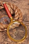 map and magnifying glass - stock photo