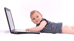 Hi Tech Baby. Boy playing with a laptop against white background - stock footage
