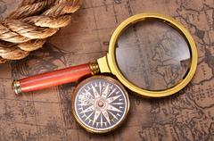 Map and magnifying glass Stock Photos