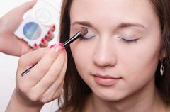 Beautiful model paint eyelids Stock Photos