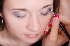 makeup artist paint brush ever model - stock photo