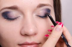 drawing shadows on the eyelids as makeup - stock photo