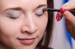 makeup artist paint brush forever young girl - stock photo