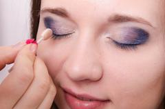 makeup artist is shaded eyelids model - stock photo